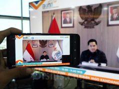Tampilan layar menampilkan Menteri BUMN Erick Thohir memberikan sambutan saat Pelepasan Jelajah BUMN 2021 BUKANJAGOKANDANG di Jakarta, Kamis (29/7/2021). Jelajah BUMN Bukan Jago Kandang diharapkan dapat memberi informasi bagi masyarakat luas mengenai apa saja yang sudah dan akan dilakukan perwakilan BUMN Indonesia di luar negeri. Termasuk, apa saja potensi bisnis yang dapat dimanfaatkan untuk membuka peluang yang lebih luas. Bisnis - Eusebio Chrysnamurti